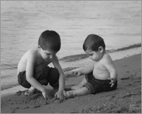Black and White Child Portrait of two brothers on the beach