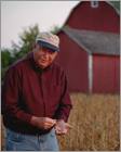 Individual Portrait of soybean farmer in field